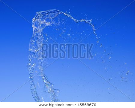 bright splash of water against the blue sky