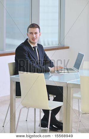 Young Business Man Alone In Conference Room