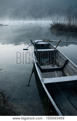 The boat sailed quietly in the misty morning.