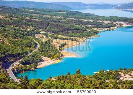 Magnificent lake with emerald water among wooded hills. Canyon of Verdon, Provence, May
