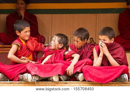 Lamayuru India - June 17 2012: Restless boys monks as spectators at the Cham Dance Festival of Tibetan Buddhism in Lamayuru monastery Ladakh India.