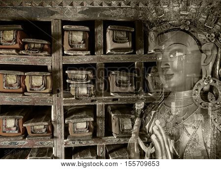 Spirit of the library - double exposure composition of the tibetan library and close-up of Buddha Maitreya statue from Thikse monastery Ladakh India.