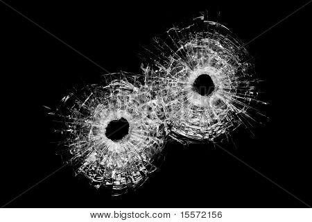 Bullet Holes Isolated On Black
