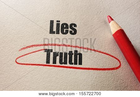 Red circle around Truth with Lies text and pencil on textured paper
