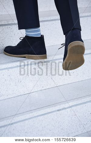 Man walking upstairs in boots close up