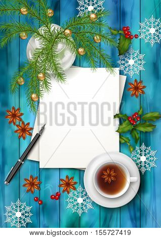 Christmas tea party background. Holiday top view background with cup of tea tree branches blank paper sheet ornament and star anise on wooden table