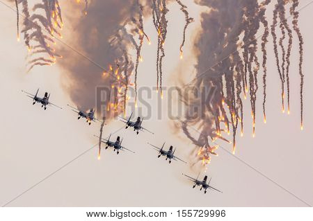 Omsk, Russia - March 19, 2016: Aircraft Sukhoi Su-27 of the Military Air forces of Russia perform aerobatics at an Airshow Russian Knights