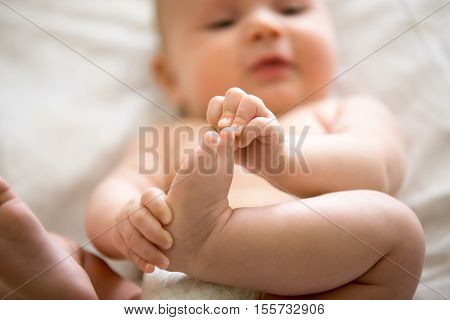 Adorable Baby Taking An Interest In His Feet