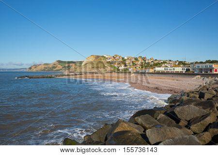 West Bay Dorset uk beach rocks and coast view to Golden Cap