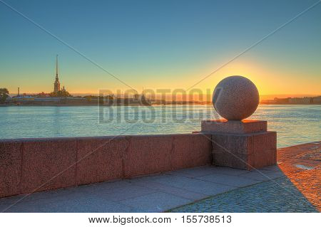 Spit of Vasilyevsky Island and Neva River at dawn with granite ball in front of sunrise Saint Petersburg Russia