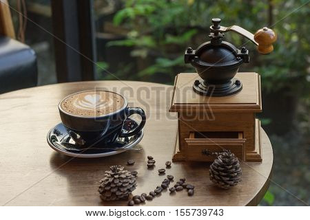wooden traditional coffee maker with hot coffee coffee seed on wooden table in coffee shop on natural view at relax coffee time / coffee maker and hot coffee