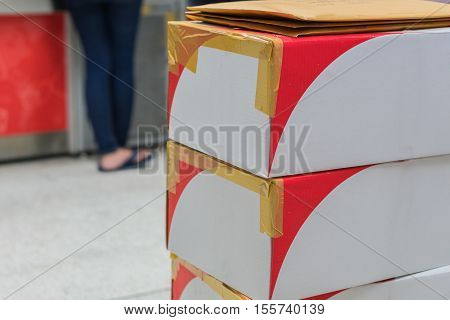 The Brown cardboard boxes arranged in stack