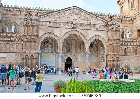 PALERMO ITALY - OCTOBER 2 2012: The richly decorated facade of Cathedral of Assumption of Virgin Mary with fine carved patterns and sculptures on its portico on October 2 in Palermo.