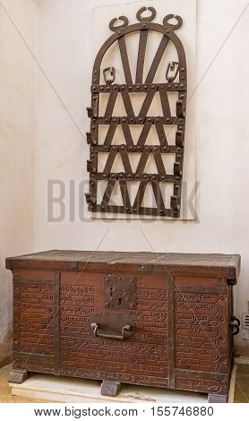 KAIROUAN TUNISIA - AUGUST 30 2015: The medieval wooden furniture decorated with carved inscriptions in the Mausoleum of Zaouia of Sidi Amor Abbada on August 30 in Kairouan.