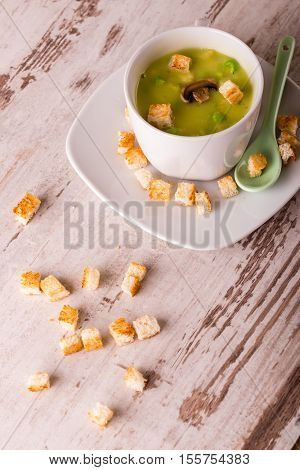 Few Spilled Croutons In Front Of Split Pea Soup