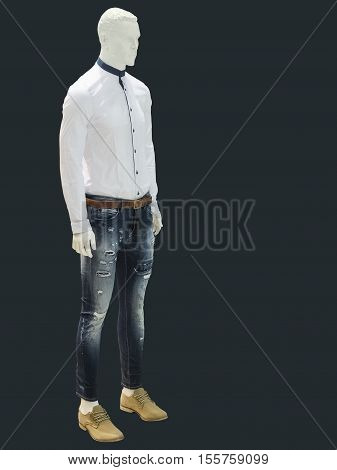 Full-length male mannequin dressed in shirt and jeans isolated. No brand names or copyright objects.