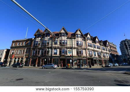 QUINCY, MA, USA - OCT. 20, 2013: Adams Building, built in 1880, is a historical commercial building with Tudor Revival style at Hancock Street in downtown Quincy, Massachusetts, USA. Now this building is a US National Historic Landmark.