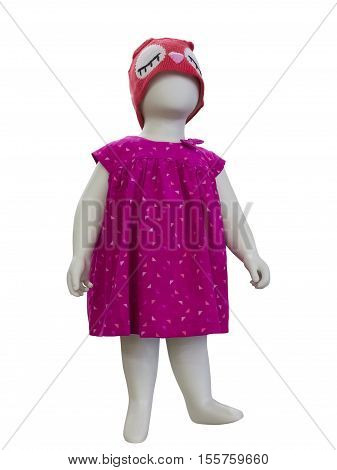 Child mannequin dressed in fashionable kids wear. Isolated on blue background. No brand names or copyright objects.