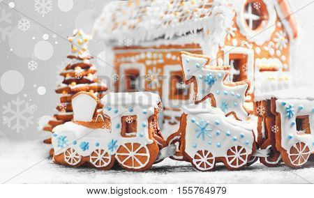 Christmas card. Assorted Christmas gingerbread cookies. Christmas gingerbread village house train tree. Christmas New Year's background with snowflakes. Christmas food gingerbread house train tree.