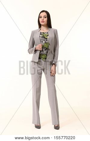 woman straight hair style in two pieces jacket and trousers power pant suit high heels shoes full length body portrait standing isolated on white