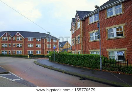 Bracknell,England - October 25, 2016: Red brick apartment blocks next to the road on a modern housing estate in Bracknell, England