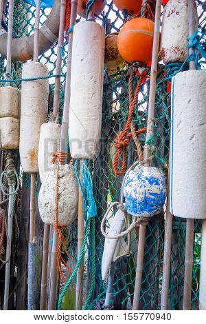 Closeup of old colorful mooring ropes Old buoys and fishing gear at the island Texel. Netherlands