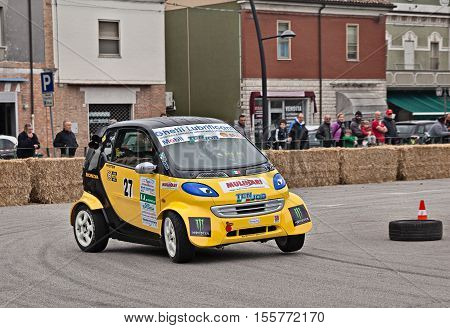 SAN PIETRO IN VINCOLI, RAVENNA, ITALY - OCTOBER 23: driver on a racing car Smart Fortwo powered by Honda engine in