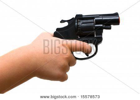 Child Hand Holding A Toy Gun