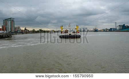 Woolwich Ferry crossing the River Thames in London and taken of the second ferry which crosses at the same time.