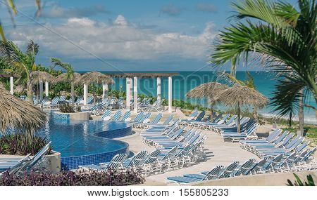 Santa Maria island, Eurostar hotel, Cuba, Nov. 23, 2013, beautiful gorgeous inviting view of luxury modern theatrical style swimming pool against tranquil, turquoise tender ocean and blue sky background