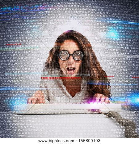 Woman with astonished expression and eyeglasses with computer keyboard