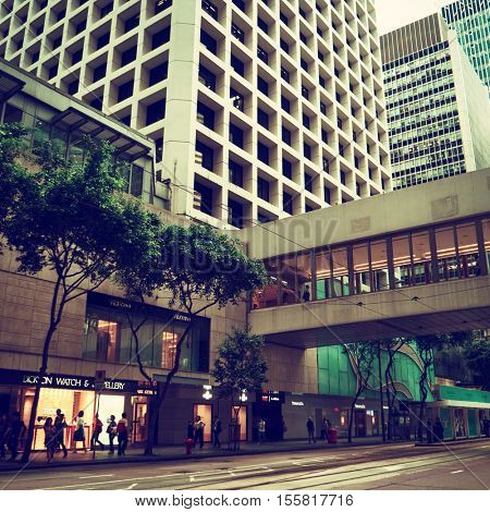 HONG KONG - October 2016: Street view with people and skywalk at Central.