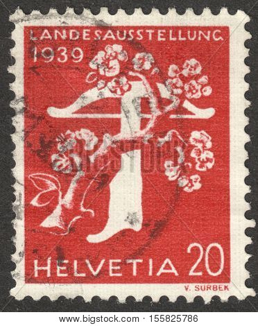 MOSCOW RUSSIA - CIRCA OCTOBER 2016: a post stamp printed in SWITZERLAND shows a crossbow with apple blossom the series