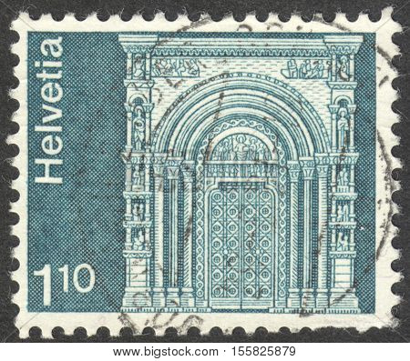 MOSCOW RUSSIA - CIRCA OCTOBER 2016: a post stamp printed in SWITZERLAND shows Gallus Gate Munster Basel the series