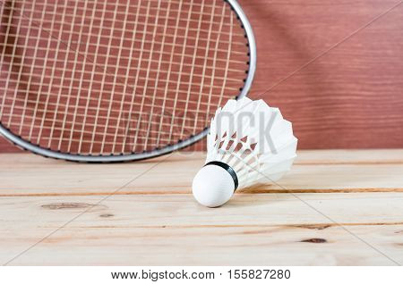 The Badminton White Shuttlecock And Racket On Nature Wooden Background