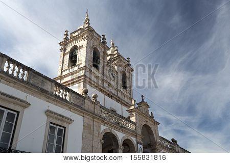 The imposing Church of Our Lady of Nazare (Igreja de Nossa Senhora da Nazare) located on the hilltop O Sitio overlooking Nazare Portugal