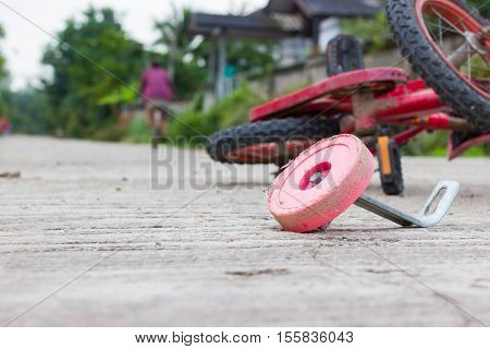 horizontal photo of closeup bicycle for children accident on the city street.