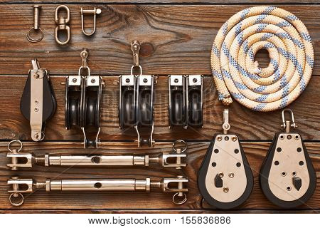 Sailing yacht rigging equipment on wooden background
