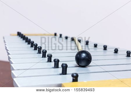 The metallophone and mallet on the white background