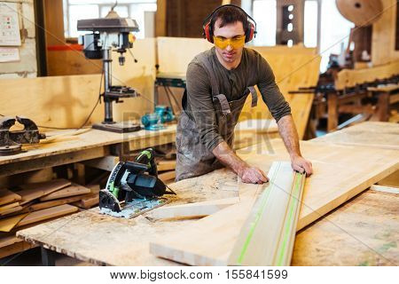 Working at cabinetmaking factory