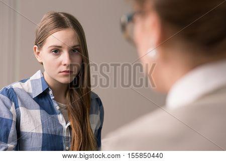 Sad And Depressed Teenager At Psychologist