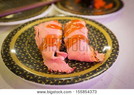 Sushi Beef Twin With Sauce In Restaurant.