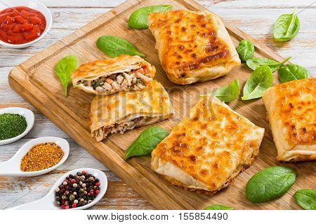 Fried Flatbread Wraps Stuffed With Chicken Meat And Vegetable