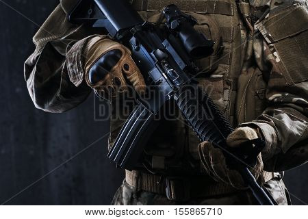 Preparation for military action. Ammunition Soldier. Soldier dressed in protective equipment