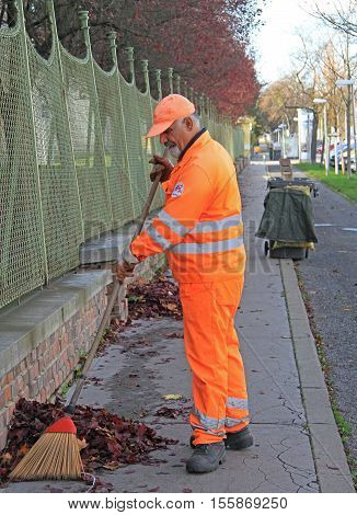 Man Is Sweeping Outdoor In Vienna, Austria