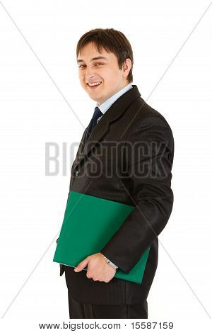 Laughing modern businessman holding folder in hand isolated on white