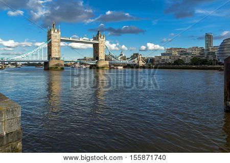 LONDON, ENGLAND - JUNE 15 2016: Sunset panorama of Tower Bridge in London in the late afternoon, England, United Kingdom