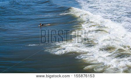 San Diego, USA - September 27, 2013. One surfer on the beach waves. San Diego California