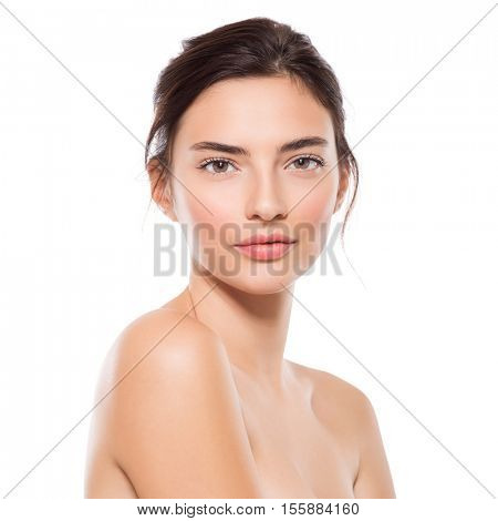 Close up portrait of young beautiful woman looking ta camera. Face of beauty girl isolated on white background. Youth and skin care concept
