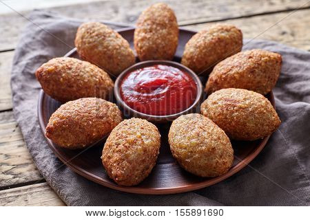 Kibbeh traditional middle eastern arabic restaurant lamb goat or camel meat stuffed bulgur kofta spicy meatball croquettes food on vintage wooden table background